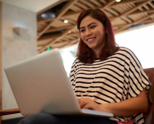 Asian Woman Using Laptop