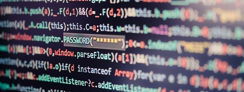 Computer screen displaying program code, website development, application building, password